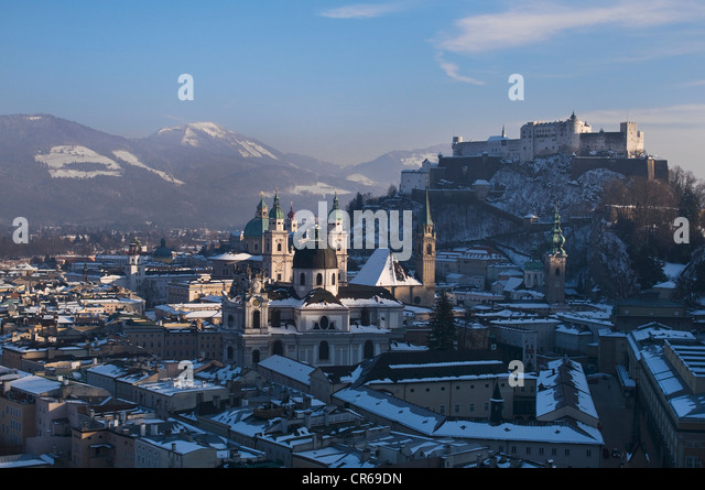 Impressive view of the wintry town of Salzburg, UNESCO World Heritage Site, university, cathedral and castle, Austria, - Stock Image