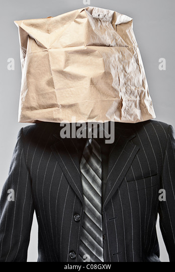 Shot of a Business Man with a Brown Paper Bag over his Head - Stock Image