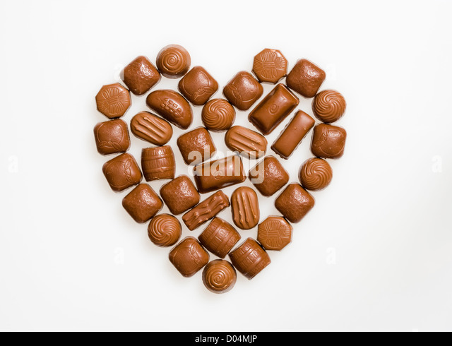 Chocolates in heart shape. - Stock Image