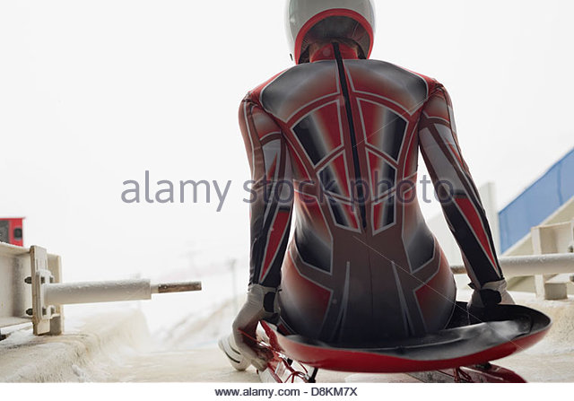 Female luge athlete at starting line - Stock Image