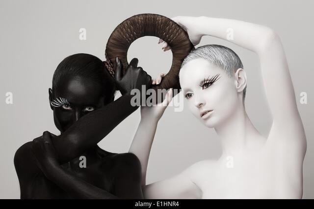 Fantasy. Yin & Yang Esoteric Symbol. Black & White Women Silhouettes - Stock-Bilder