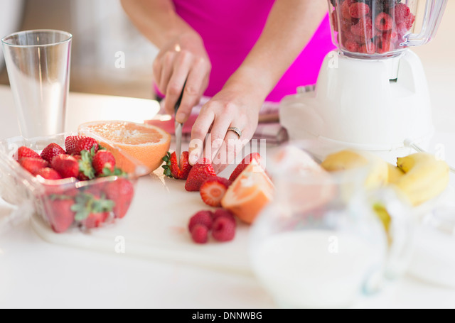 Woman slicing strawberries - Stock Image