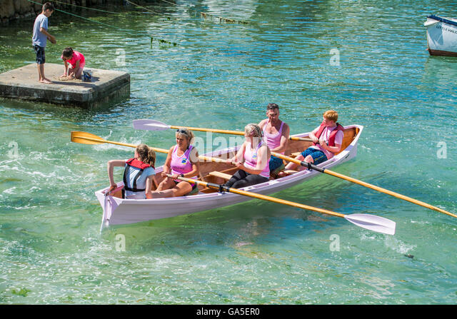 Mousehole harbour, Cornwall, UK. 3rd July 2016. UK Weather.  Warm sunny day in Mousehole for  gig racing, with teams - Stock Image