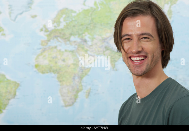A Man in front of a world map - Stock Image
