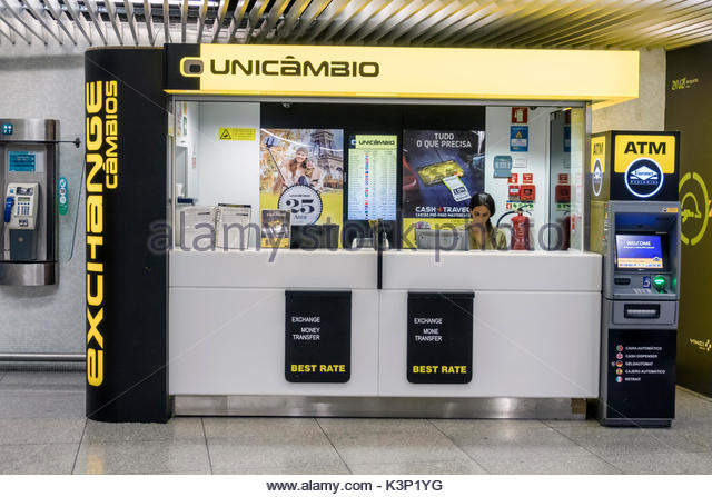 Lisbon Portugal Humberto Delgado Airport LIS Portela Airport currency exchange kiosk Unicambio ATM woman agent - Stock Image