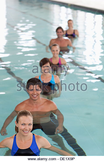 Six people in swimming pool - Stock Image