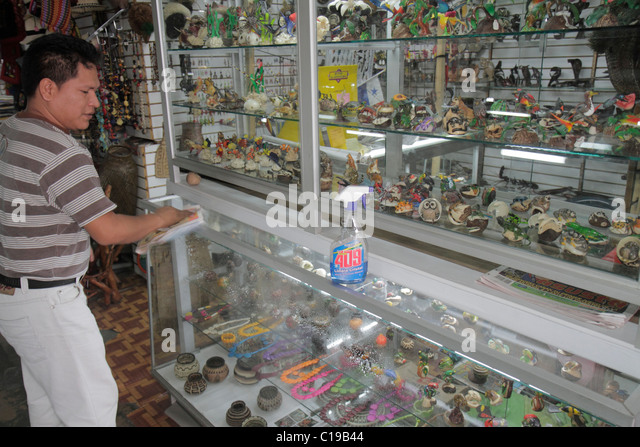 Panama City Panama Balboa Centro de Artesenias shopping handicrafts business souvenirs figurines display case Hispanic - Stock Image