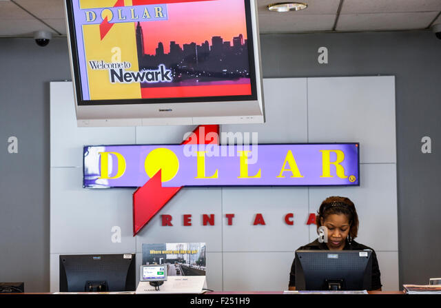 New Jersey Newark Newark Liberty International Airport EWR Dollar Rent a Car reservation pick up desk location Black - Stock Image