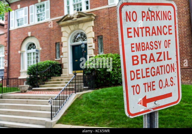 Washington DC District of Columbia Kalorama Heights Embassy Row diplomatic building restricted parking sign Embassy - Stock Image