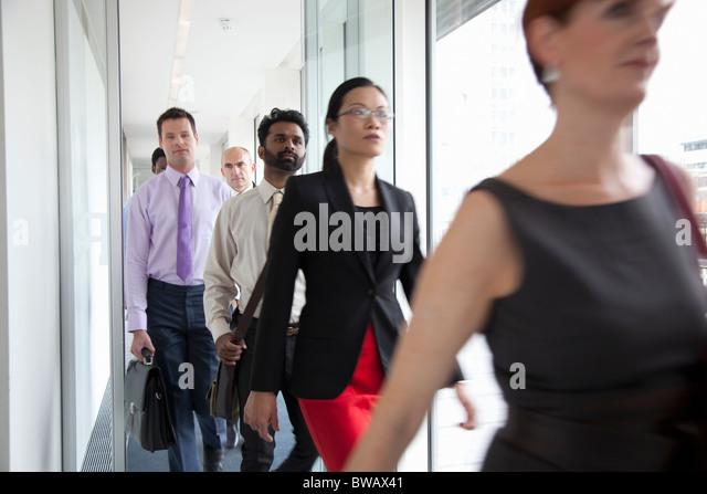 Business people rushing past camera - Stock-Bilder