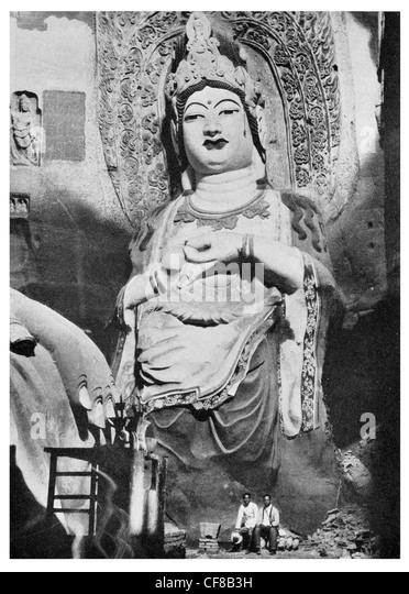 1927 Gigantic deities Kwan Yin Goddess of Mercy temple Tafotse near Pinchow Shensi Province china - Stock Image