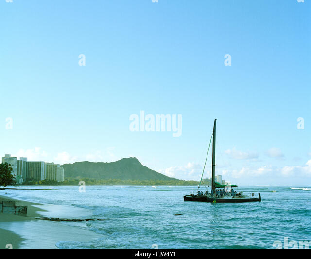 Catamaran Maitai and Diamond Head Waikiki Beach Oahu Hawaii - Stock Image