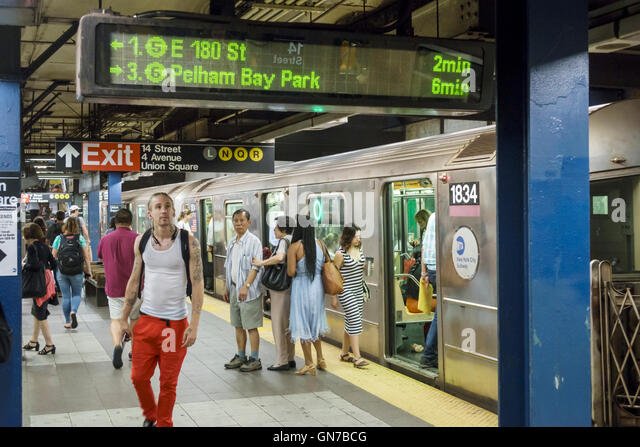 Manhattan New York City NYC NY Midtown 14th Street-Union Square subway station platform train MTA public transportation - Stock Image
