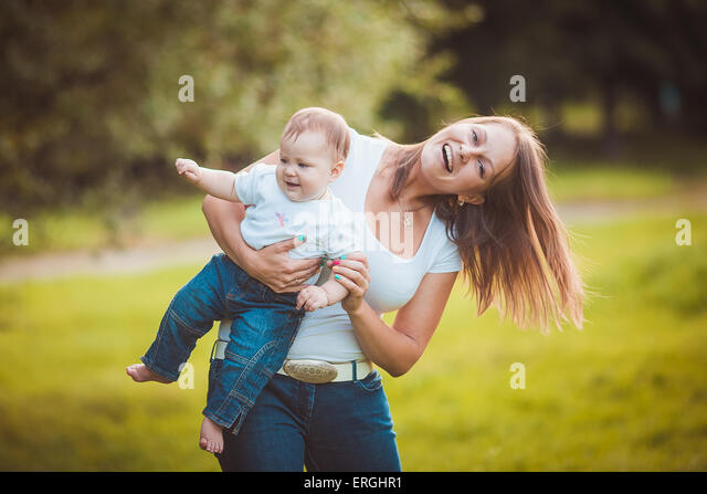 Happy mother with baby - Stock Image