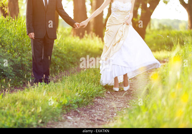 Bride and groom, walk in the nature - Stock Image