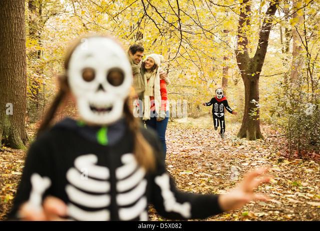 Children in skeleton costumes playing in park - Stock-Bilder