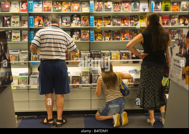 Marbella Malaga Province Costa del Sol Spain La Canada shopping centre Choosing DVD films in FNAC shop - Stock Image