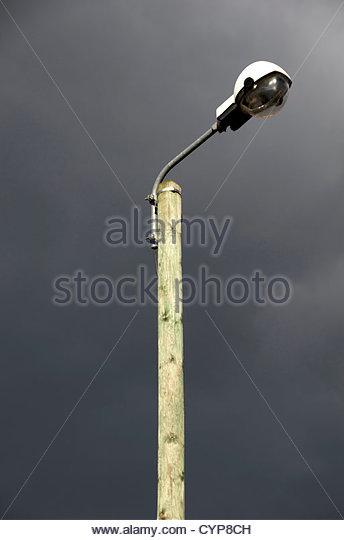 Street lamp on wooden pole - Stock Image
