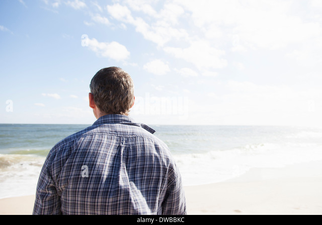 Man looking out to sea, Satellite Beach, Florida, US - Stock Image