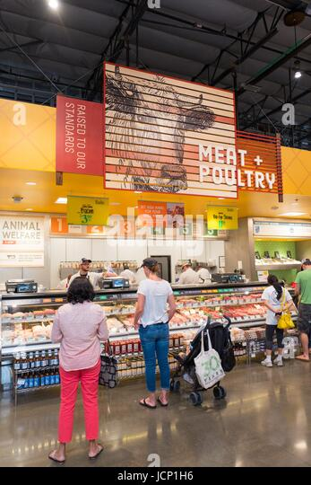 Dublin California, United States. 16 Jun, 2017. Shoppers purchase meat and poultry at Whole Foods Market grocery - Stock Image