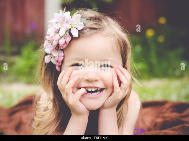 Portrait of a girl laughing - Stock Image
