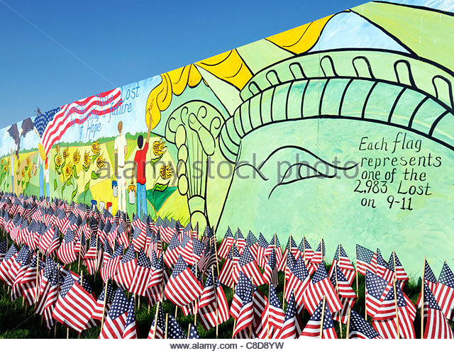 An American flag for each victim of the 9 11 attacks on America in front of a painted mural on the 10th anniversary. - Stock-Bilder