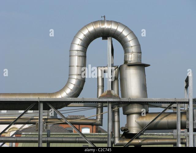 U bend in industrial pipework - Stock Image