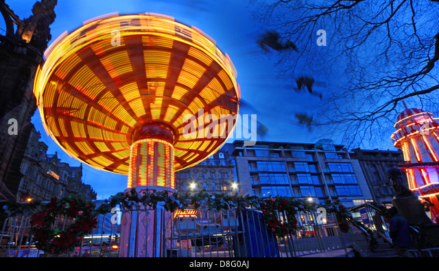 Merry Go Round at dusk Princess St Gardens Edinburgh City Scotland UK - Stock Image