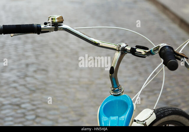Helm of bicycle which is standing on the street of old city - Stock-Bilder