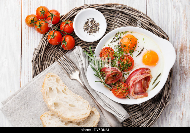 Breakfast with Fried eggs and bacon - Stock Image