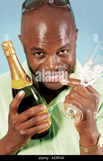 Man with Champagne and glasses - Stock Image