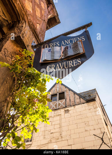 Hanging shop sign for old books and engravings - Chinon, France. - Stock Image