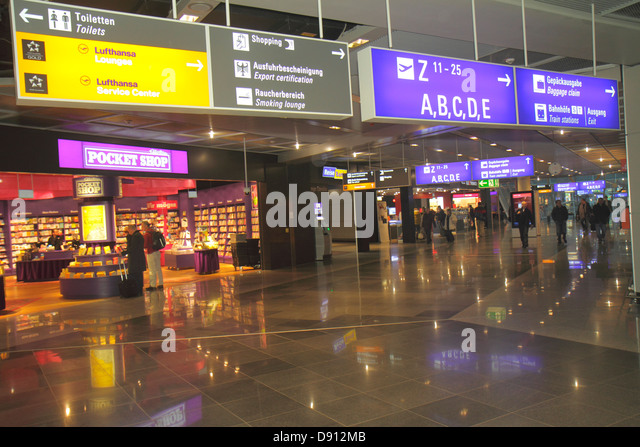 Germany Frankfurt am Main Airport FRA terminal gate area concourse shopping signs information directions Lufthansa - Stock Image