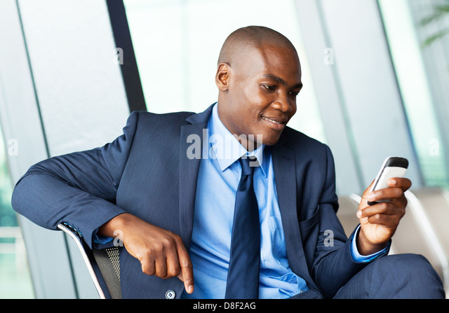 handsome african american businessman using smart phone emailing - Stock-Bilder