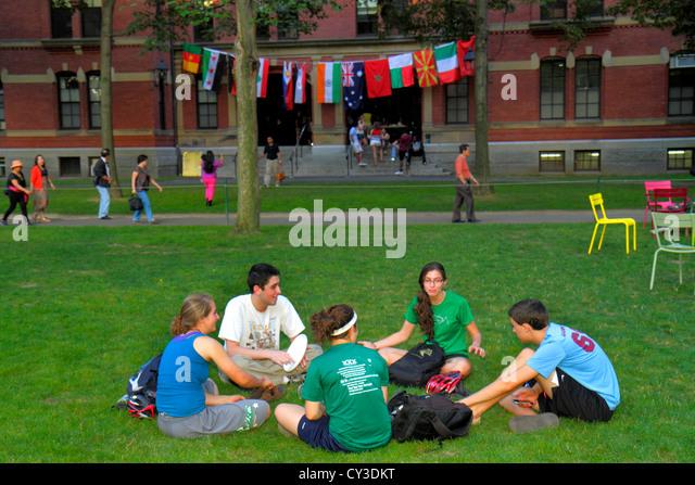 Boston Massachusetts Cambridge Harvard University campus Harvard Yard teen boy girl student sitting Weld Hall dormitory - Stock Image
