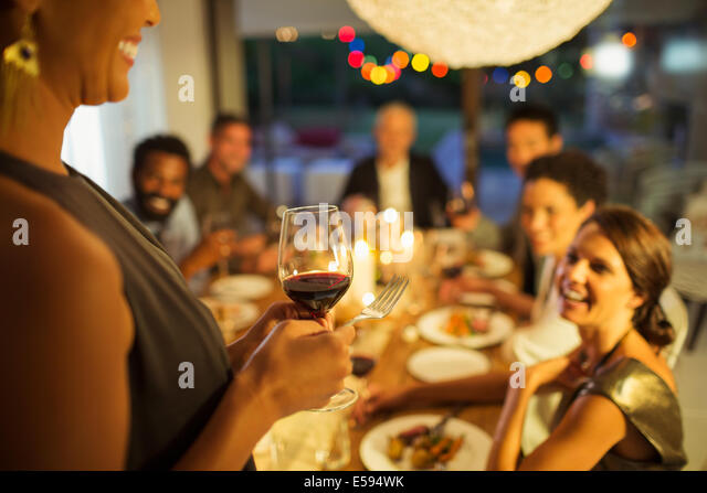Woman proposing a toast at party - Stock Image