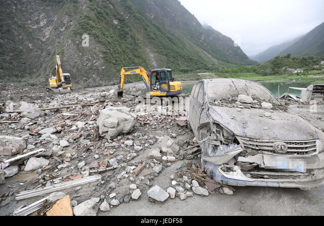 Maoxian, China's Sichuan Province. 24th June, 2017. Rescuers work at the accident site after a landslide occurred - Stock Image