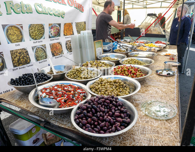 Bowls of Olives for sale at food festival with market stall Bakewell Derbyshire England - Stock Image