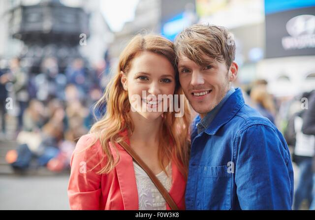 Portrait of tourist couple at Piccadilly Circus, London, UK - Stock-Bilder