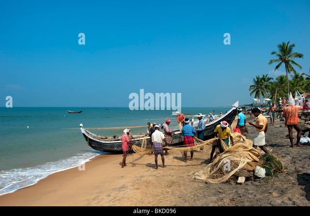 Samudra Beach with Fishermen, Kovalam, Kerala, India - Stock Image