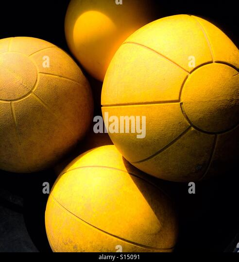 Yellow medicine balls - Stock Image