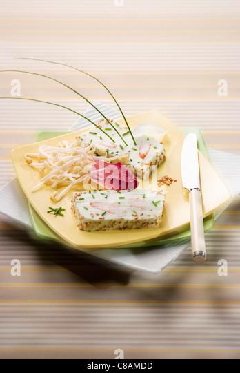 Cream cheese, crab and sesame seed terrine - Stock Image