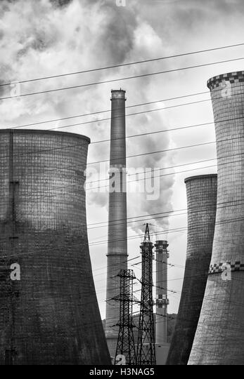 Coal Power plant with smoke and steam released in the atmosphere (pollution and global warming concept) - Stock Image
