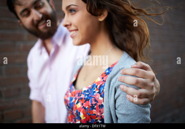 Handsome man embracing young girl while walking outdoors - Stock-Bilder