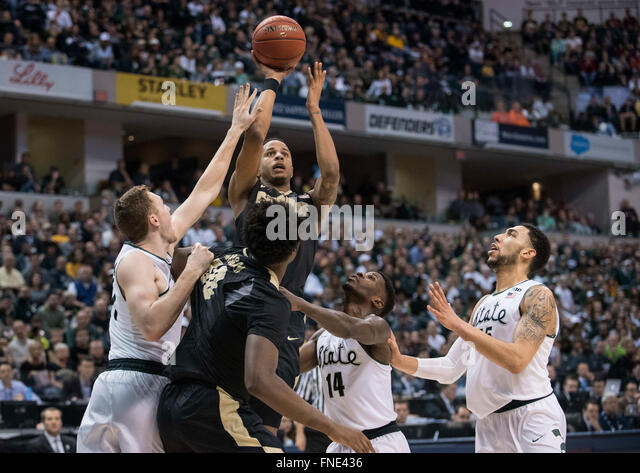 Indianapolis, IN. USA. 13th Mar, 2016. Purdue Boilermakers forward Vince Edwards #12 hits a shot over Michigan State - Stock Image