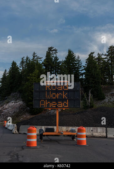 Road Work Ahead Construction Sign Vertical indicates warning of delays - Stock Image