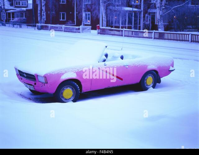 car cold color image convertible motoring pink Scandinavia snow snowed in Sweden traffic transport vertical winter - Stock-Bilder