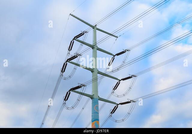 Utility poles supporting wires for various public utilities - Stock Image