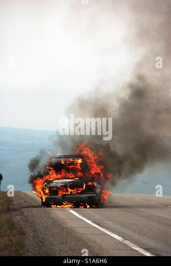 Car on fire - Stock-Bilder