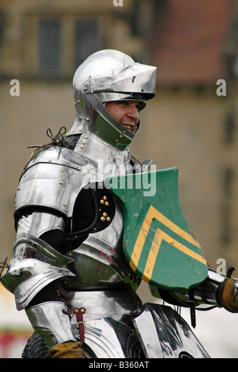 Smiling Knight in Armour with Shield - Stock Image